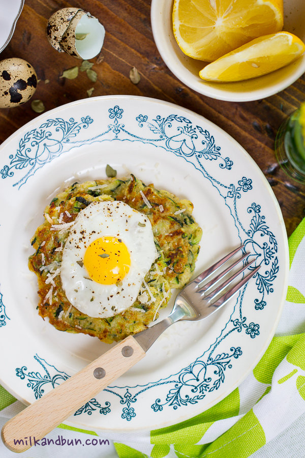 Zucchini oladushki with fried quail eggs