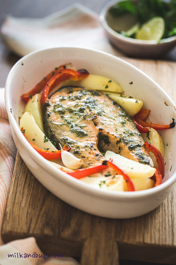 Herb-marinated roasted salmon with capsicum and potato slices