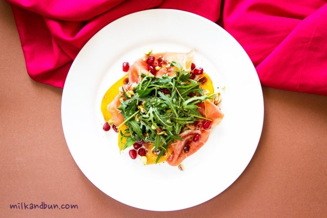 ProsciuttoSalad with persimmon and pomegranate seeds